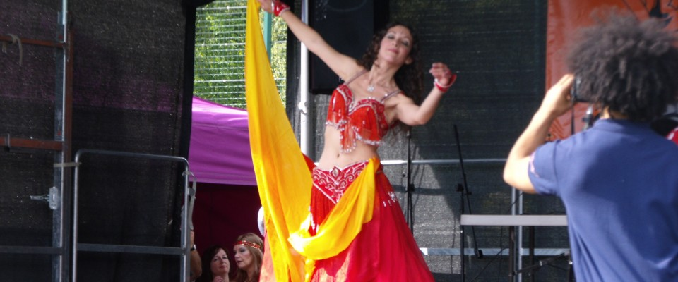 Performing at Popcorn in the Park in Derby. Photo © Pure Belly Dance, 2011