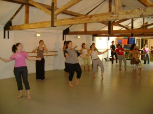 Teaching a belly dance class at yoga home